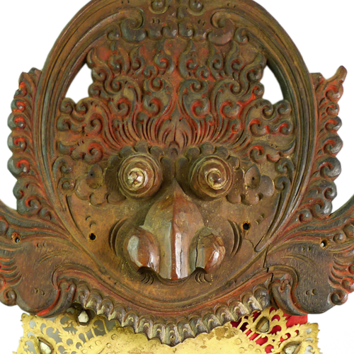 Bali face intricately carved with leather and cloth fire tongue